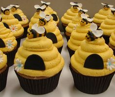 Bee Hive Cupcakes by jmccustomcakes.com--LOVE the swirled beehives!