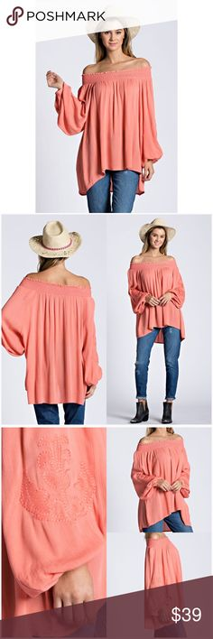 "Coral Embroidered Off-Shoulder Tunic  This slight high low tunic, has a soft flowy fit, not to mention this beautiful coral color.  Features embroidery on the sleeves and smocking around the neckline for a comfortable off-shoulder fit. *Crinkle gauze material consisting of 100% rayon.  Small:        Bust: 52"" Length: 22"" Medium:    Bust: 56"" Length: 22"" Large:        Bust: 58"" Length: 23.5""  ❗️Length measurement is from center of smocked collar to shortest point at center front of blouse…"
