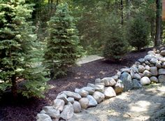 Boulder Retaining Walls are our specialty by Northern Lakes Floral and Garden Center I Walker, Minnesota