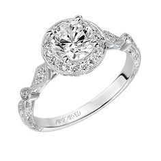 engagement ring with a diamond halo and hand engraved etching.  Style: Crystal #ArtCarvedBridal #ArtCarvedPinterest