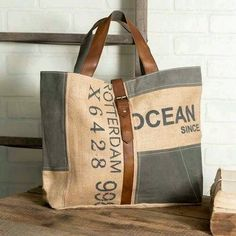 This eye catching Ocean Spirit tote bag is made of canvas with leather drop handles and leather buckle type closure. It has inside ticking lining and an inside pocket. This tote bag measures x x Sacs Tote Bags, Canvas Tote Bags, Reusable Tote Bags, Diy Bags Purses, Cute Purses, Large Bags, Small Bags, Burlap Purse, Burlap Bags