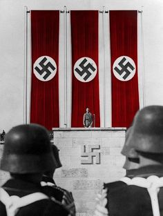Hitler conducts a speech to tens of thousands of National Socialists during a Reichsparteitag held at Zeppelinfeld, Nürnberg. This photo was colorized in a brilliantly striking fashion, displaying just how eye-catching the banners of the German Reich truly were.
