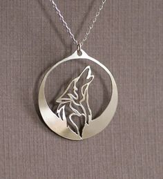 Howling at the Moon Wolf Necklace The wolf howls into the inky darkness of night as its majestic profile is captured under the light of a glowing silver
