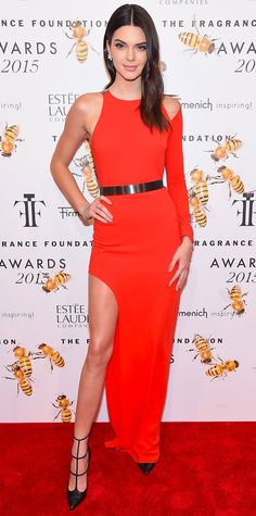 Kendall Jenner struck a pose at the 2015 Fragrance Foundation Awards in a red-hot one-shoulder, cut-out asymmetric Halston Heritage number that she styled with diamond cluster Chopard earrings, a metallic belt, and strappy pumps.
