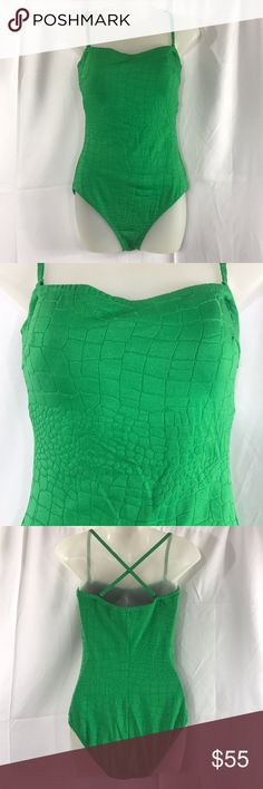 Gottex One Piece Swimsuit Green Size14 Gottex Green One Piece Swimsuit. Size 14. Removable straps. Green textured material that makes it look like snake or reptile skin. Preowned in great condition with no peeling or snags and stain free. Comes from smoke free and clean home. Measurements in pictures. All items photoed before shipping. Thanks. Profile By Gottex Swim One Pieces