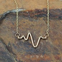 Golden heartbeat necklace. Great gift for nurses, medical students, and doctors.