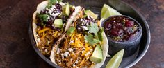 Pumpkin plus pork equals tacos that pop. The five-ingredient cranberry-lime salsa puts them over-the-top!