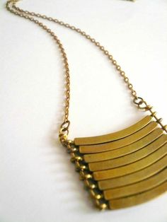 Curved geometric necklace with military style vintage brass bars.