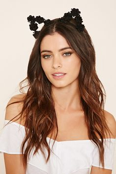 A wrapped wire headband featuring protruding cat ears decorated with fabric flowers.