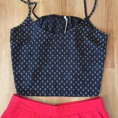 Nautical Print Crop Top⚓️ Adorable Navy Blue Crop Top with white & red anchor print.  Cute bow detail on back.  Brand New, never worn!  Could definitely fit a small.  Layer  it or wear alone with high waisted shorts or a maxi skirt.  So fun for summer! Boutique Tops Crop Tops