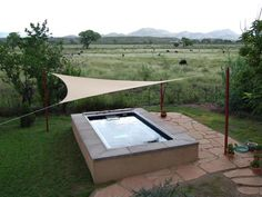 Next to a cattle ranch, there's just the spot to convene with nature in this lap pool by  Endless Pools.  The triangular tarp provides sun protection and a hint of hip design.