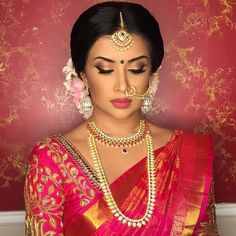 South Indian bride. Gold Indian bridal jewelry.Temple jewelry. Jhumkis.Red silk kanchipuram sari. Braid with fresh flowers. Tamil bride. Telugu bride. Kannada bride. Hindu bride. Malayalee bride.Kerala bride.South Indian wedding. Pinterest: @deepa8