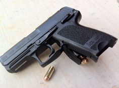 HK USP Compact .40 and I LOOOOVE mine!!! Find our speedloader now! http://www.amazon.com/shops/raeind