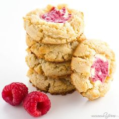 These easy raspberry cheesecake thumbprint cookies are gluten-free & low carb. A cream cheese shortbread cookie with a raspberry swirl cheesecake center!