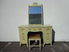 3PC Country French Vanity Desk Absolutely charming and gorgeous antique desk with mirror and matching chair. Expertly crafted with no detail spared. Solid and painted a very pretty pale green and perfectly distressed. The desk features 7 dovetail drawers, original hardware and ample work space. The coordinating vanity mirror is set in a fantastic frame. The vanity bench needs to be recovered. This is a definite focal set and will be perfect in any space. Provincial shabby chic chalk paint…