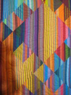 close up, Haze Kilim quilt by Lori Allison.  Kaffe Fassett pattern //what a cool idea--the stripes blend into each other.  Time to collect more Kaffe stripes!