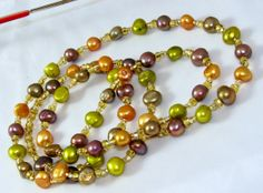 Flirty & Fun Multicolored Freshwater Pearl & Gold Beaded Eyeglass Necklace by nonie615, $43.00 I can convert to an ID or Key Lanyard as well.