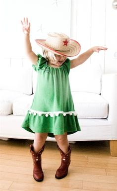 Green dress, cowgirl boots, hat, arms swinging high in the air....yeah, she's got it going on.