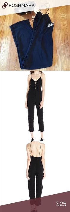 NEW Women's Lace-Up Jumpsuit Women's  black lace-up jumpsuit. Size large. Note: Cropped leg with plunge Lace-up neckline. 100% viscose. Hand wash. New with tags. Motel Rocks Other