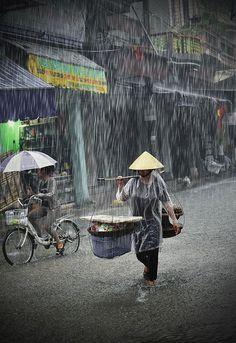 In the Rain - Hanoi, Vietnam. Pouring rain, rain photography rainy day, rain photographs.
