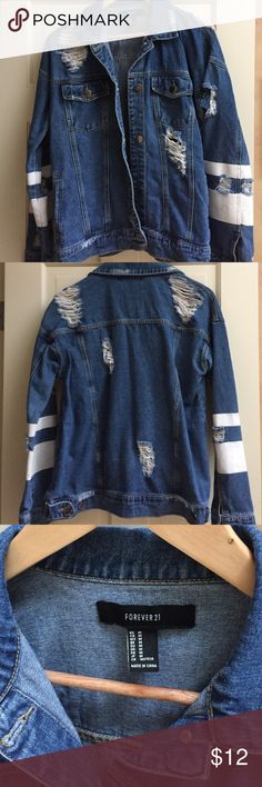 "Denim jacket. Size M. ""Distressed"" design. Denim with distressed look. Stripe accents on sleeves. Button closure front. Button accents on back hem for adjustment at waist. Fun jacket Forever 21 Jackets & Coats Jean Jackets"