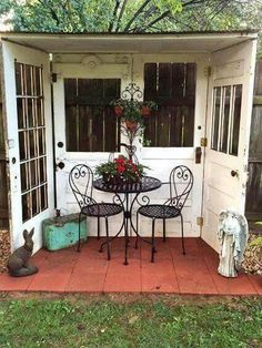 Great idea for using four old doors to create a nook in the backyard!
