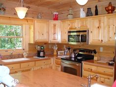 Blowing Rock Kitchen designed by Blue Ridge Log Cabins #cabincooking #loghomes #logcabins #kitchen #kitchendesign