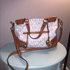 Rare Michael Kors Fallon Debating on selling my very rare, gently used Fallon satchel. This has the vanilla monogram print and cognac trim/details. Gold hardware. Can be worn crossbody style too. No flaws that I can see! Reasonable offers will be considered! Michael Kors Bags Satchels