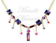 Purple and pink Swarovski necklace. Sparkling statement jewelry  with flat rounds and squares accented by dangling crystal bicones. By Moonlit Memory on Etsy.