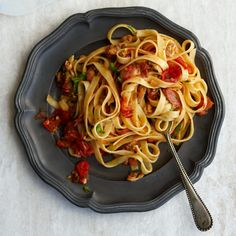 Clams and bacon form a delectable union enhanced by wine-flavored tomato sauce. We recommend chopped clams, which are sold in refrigerated containers Clam Recipes, Seafood Pasta Recipes, Bacon Recipes, Wine Recipes, Great Recipes, Cooking Recipes, Favorite Recipes, Linguine Recipes, Linguine And Clams