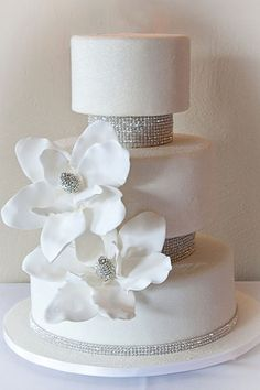 wedding cakes with bling KatieSheaDesign Southern Magnolia Wedding Cake trimmed with crystals and edible glitter White Wedding Cakes, Elegant Wedding Cakes, Cool Wedding Cakes, Beautiful Wedding Cakes, Gorgeous Cakes, Pretty Cakes, Cute Cakes, Amazing Cakes, Bling Cakes