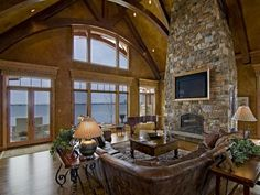 soaring stone fireplace and stunning views