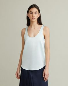 Scoop-neck tank top with smooth, heavy handfeel and scalloped hemline. Scoop neck Scalloped hemline Satin-like finish Heavy weight Loose fit polyester Model is 178 cm/ ft and is wearing an Italian size 40 Retail Concepts, Cool Suits, Apothecary, Designing Women, Bath And Body, Hemline, Basic Tank Top, Scoop Neck
