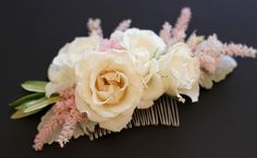 The flower girls will have small clips of ivory spray roses, blush astilbe and gray dusty miller to pin in their hair. www.stemfloral.com