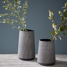 Large Black And White Etched Vase: Striking black & white etched ceramic vase with a matt textured surface. Simple, stylish Scandinavian design, this vase would be a sophisticated and modern addition to any home. This vase is the large vase on the left of the image.