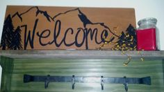 Hand-painted welcome sign.  Hand-made coat rack.