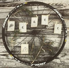 Repurposed, Upcycled, bike wheels have been handcrafted into original art pieces for the holidays. Each wreath is unique; no two look alike. Contact Urban