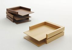 Soichiro Nomiyama for Hightide - Slide paper trays are made from a simple conception of joint work. they are available in walnut or beech wood, and have the ability to swivel outwards as the trays rotate on a steel axis.
