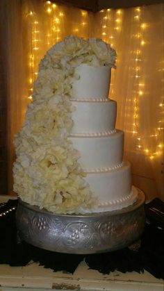 Wedding cake with cascading peonies