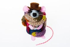 Tom Baker's regeneration of The Doctor Mouse has an eccentric style of dress and speech, particularly his trademark long scarf and fondness for jelly babies. Disarmingly loopy, brilliant and entirely serious, all at the same time. This little Doctor Who mouse has a real knitted scarf to go with his carefully hand crafted floppy hat, curly hair, jeans and chequered waistcoat. And he wouldn't be complete without his sonic screwdriver too!