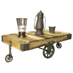 The Factory Cart coffee table is a lovely, industrial chic accent piece for your living room. Metal base and accents. Style # at Lamps Plus. Cart Coffee Table, Unique Coffee Table, Rolling Table, Modern Industrial Decor, Chandelier, Old Factory, Living Room Kitchen, Repurposed Furniture, Table Furniture