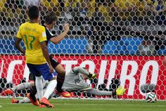 Germany's Andre Schuerrle, left, scores his side's seventh goal during the World Cup semifinal soccer match between Brazil and Germany at the Mineirao Stadium in Belo Horizonte, Brazil, Tuesday, July | Blitzkreig Jerman Luluh Lantakkan Brasil - Yahoo Sports Indonesia