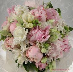 Pale pink peonies, white lisianthus,white freesias, white chincherinchees, white hyacinth and white freesias