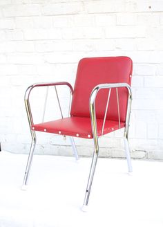 DESCRIPTION Fab mid century kids chair! Red faux leather with white buttons, and nice shiny metal frame in geometric design. Built to last, and