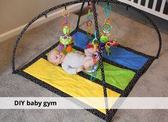 DIY baby gym. Mayb I should do this instead of just buying one.
