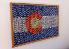 State of Colorado Beer Bottle Cap Flag. $200.00, via Etsy. Wouldn't buy it, but heck yeah I'd drink the beer and make it!
