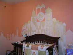 It's a Small World Nursery: The mural and idea for my nursery was inspired by the It's a Small World ride at Walt Disney World and his world travels. My husband free handed the whole