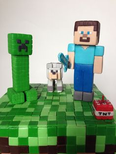 Minecraft cake - close up of Steve, diamond sword, wolf and creeper.  The TNT block was an early prototype for the candle blocks below.  It was a bit small, so I was going to throw it out, but my son convinced me to put it up on the top for extra color and for 'good luck'.