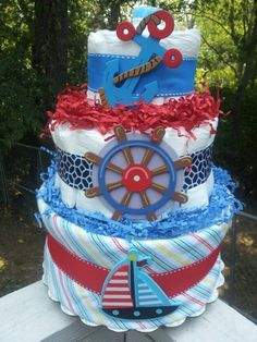 I'm buying this for her gift and decoration - Nautical  Sailboat 3 tier diaper cake baby shower decoration/centerpiece. $38.00, via Etsy.