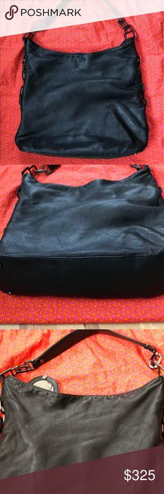 """Tory Burch black leather chain Hangbag Hobo  Excellent condition Authentic Leather is silky smooth   Size: Approx 14.5""""(L) x 12.5""""(h) x 4.5""""(W)  You will love this bag the leather is unbelievable Dust bag included   👛👀check out my closet for more handbags Tory Burch Bags"""